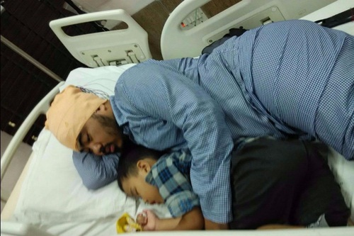 In my hospital bed with my son